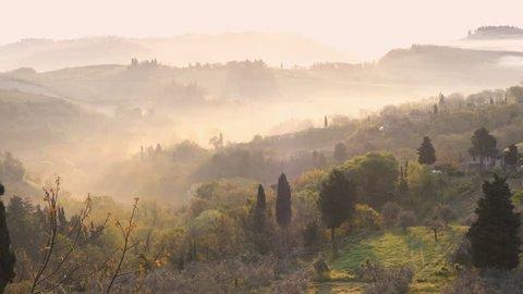 misty morning panorama from the San Gimignano walls, Toscana, Italy