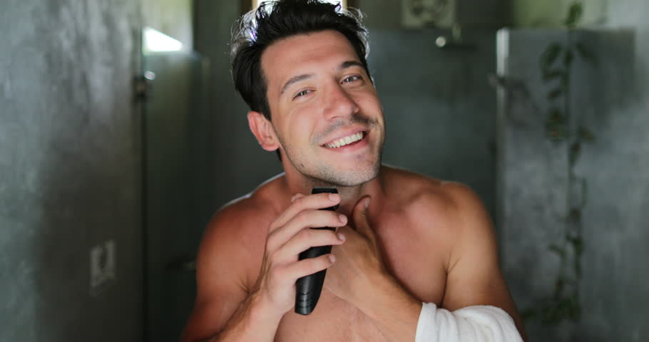 Man Shaving Win Electric Razor Looking In Mirror In Bathroom Looking In Mirror Handsome Young Guy In Morning Point Of View Slow Motion 60