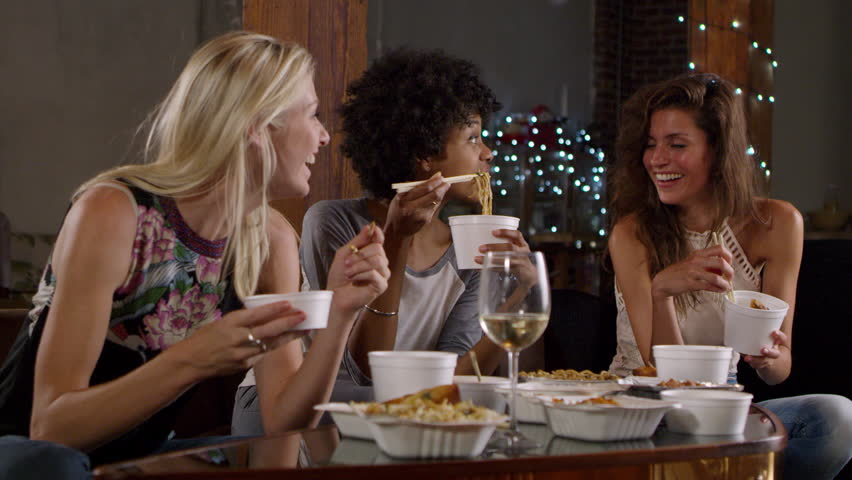 Three female friends talking and eating a Chinese take-away, shot on R3D