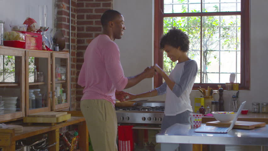 Young black couple dancing in kitchen, shot on R3D