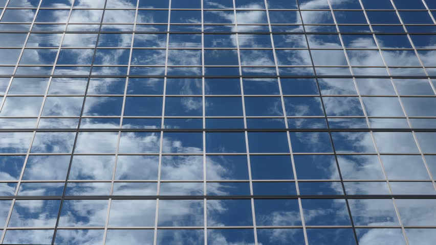 reflection of clouds and blue sky in mirrored office building real time hd