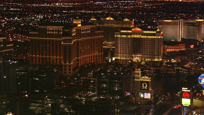 Night flight past the Bellagio and its neighbors on Las Vegas Boulevard. Shot in 2008. | Shutterstock HD Video #26825569