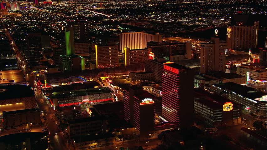 Night flight looking toward Las Vegas Strip from near Fremont Street. Shot in 2005.