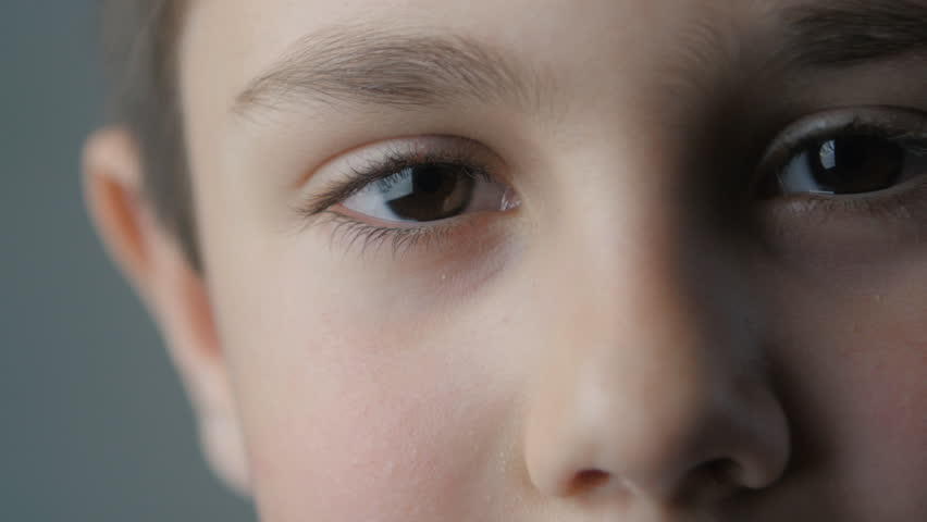 close up portrait of little boy looking at camera