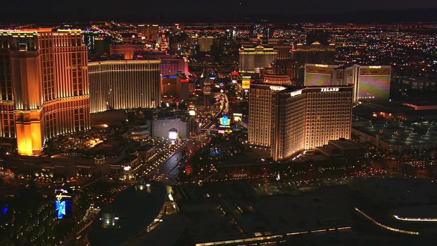 Night flight above casinos along The Strip with wide view of glittering Las Vegas. Shot in 2008. | Shutterstock HD Video #26861590
