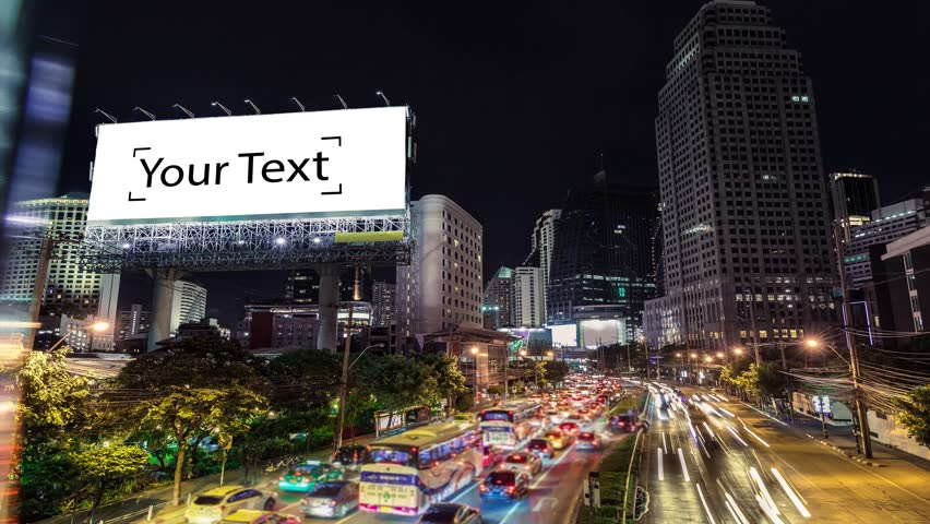 4K resolution Timelapse Cinemagraph,  The Big white blank billboard beside the road at night, Advertising background for add your text promotion or product in scene traffic communication.