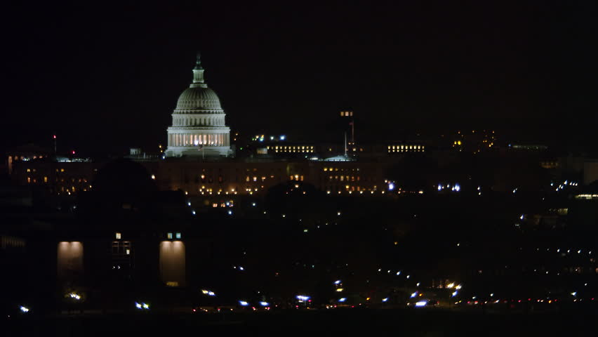 Capitol dome and Washington Monument at night; Lincoln Memorial passes through frame. Shot in 2011.