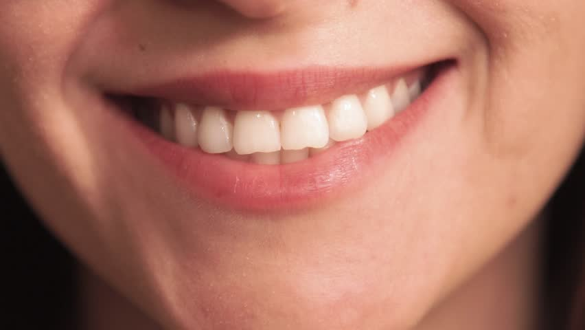 Extreme close up of girl with smile. Without lipstick.