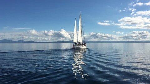 White yacht sail boat sailing over Lake Taupo North Island New Zealand