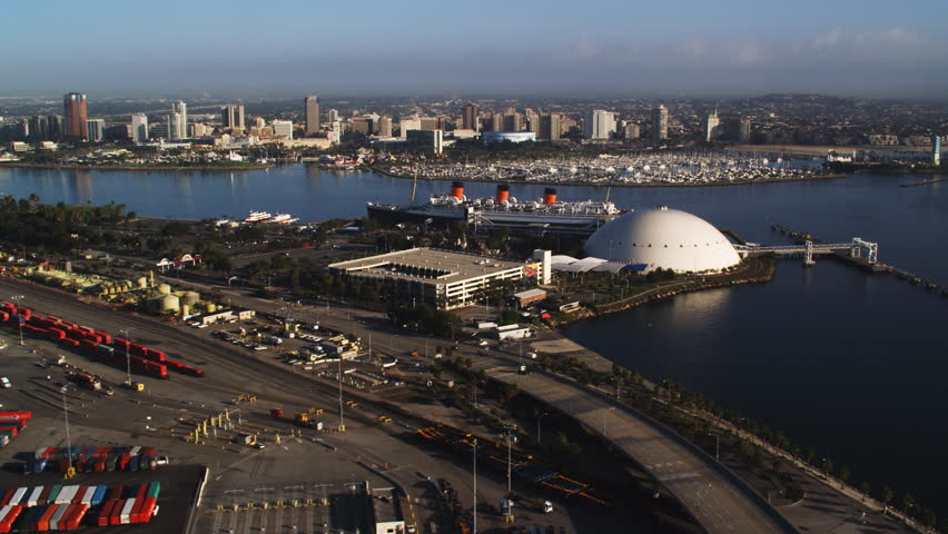 Long Beach, California, with Queen Mary moored in foreground. Shot in 2010. | Shutterstock HD Video #26909170