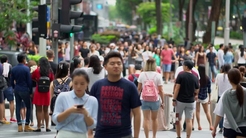 SINGAPORE CITY,SINGAPORE - MAY 13, 2017:TImelapse Crowd of unidentified people cross Orchard Road. Orchard Road is a 2.2 kilometer-long boulevard that is the retail and entertainment hub of Singapore.