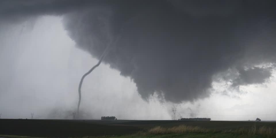 A rope tornado moves in front of a wedge tornado near Wakefield, Nebraska