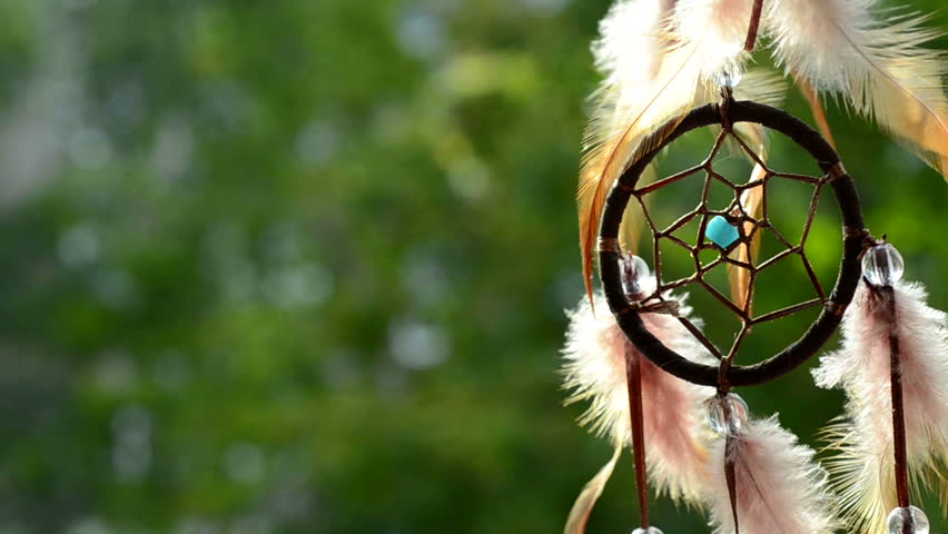 Part of a dreamcatcher in late afternoon backlit in front of part of a dreamcatcher in late afternoon backlit in front of trees turning and waving feathers stock footage video 2693870 shutterstock voltagebd Images