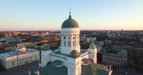 4K aerial drone footage of Helsinki old cathedral and central square area near city center and harbour market square with city skyline and Baltic Sea view in the capital of Finland, northern Europe
