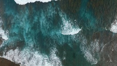 Top View of the Giant Waves, Foaming and Splashing in the Ocean, Sunny Day, Slow Motion Video, Indonesia, Bali