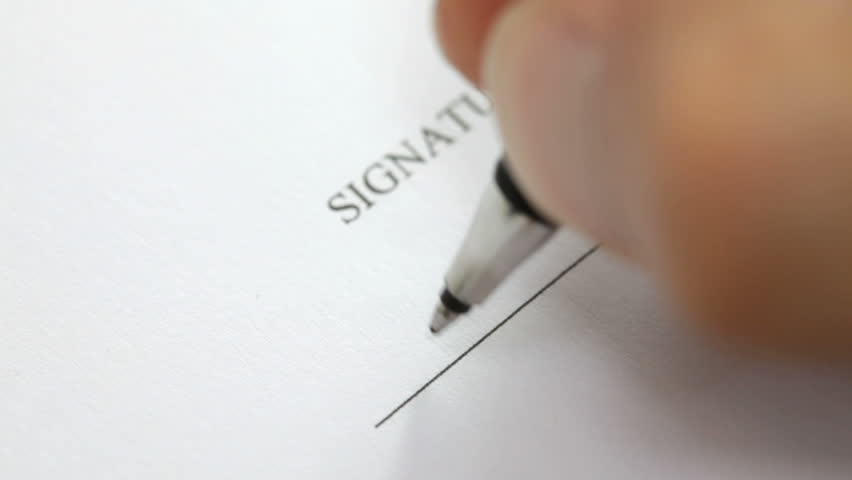Hand signing a contract in black ink. Signature is fake. Detail