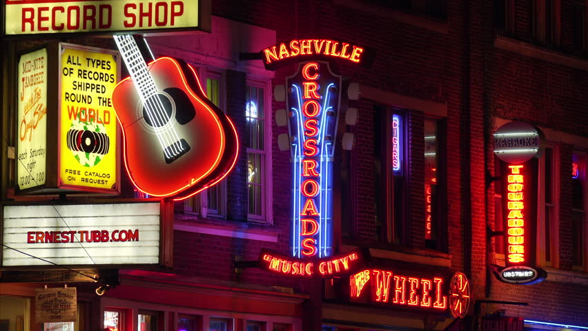 NASHVILLE, TENNESSEE - JULY 7th: Neon signs at night along Broadway Street in Nashville, Tennessee on July 7th, 2016.