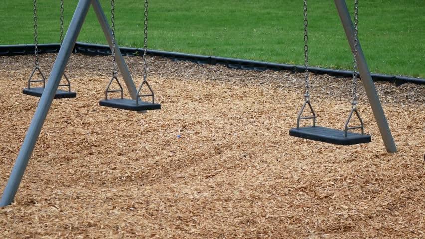 Empty swing in public park