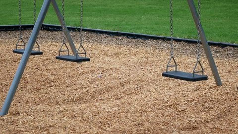 Empty swing in public park