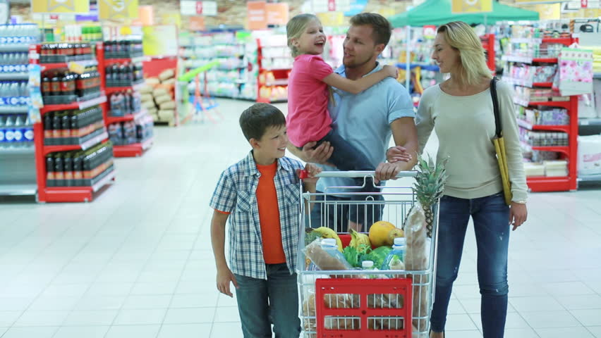 Parents and kids doing shopping together expressing their love and tenderness | Shutterstock HD Video #2707739