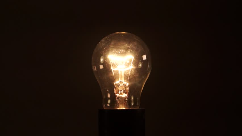 Light bulb on black background. Idea light bulb. electrical disturbances. Earth hour. | Shutterstock HD Video #27088390