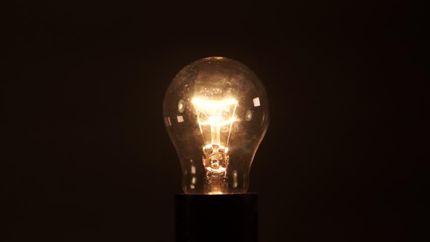 Light bulb on black background. Idea light bulb. electrical disturbances. Earth hour.