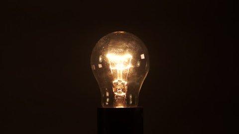 Idea light bulb on black background. electrical disturbances.