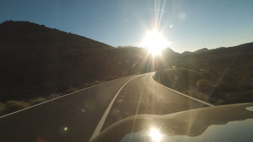 Car Taking a Gentle Right Curve in the Sunlight   Shutterstock HD Video #27091870