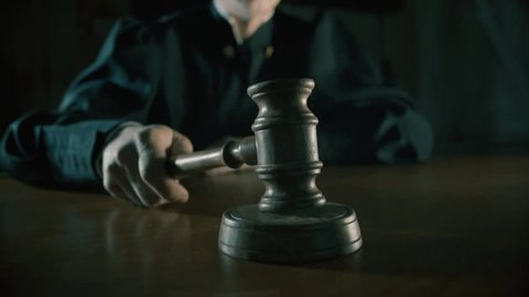 judge with a hammer in his hand in the court room