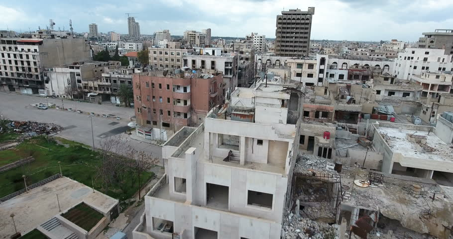A flight of a drone over the city of Homs in Syria  03/04/2017 - Homs - Syria  | Shutterstock Video #27099733