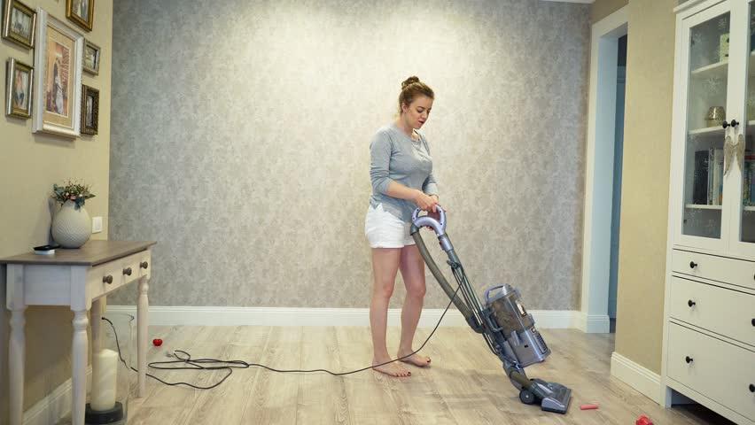 Woman cleaning using vacuum cleaner, effective. Vacuum cleaner carpet