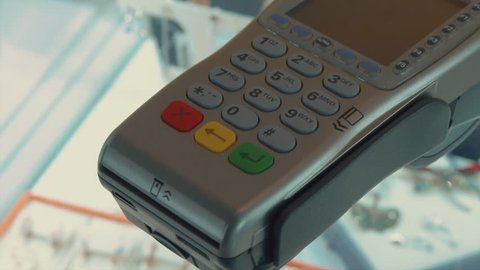 Swiping A Credit Card And Credit Card Terminal POS In A Jewelry Store