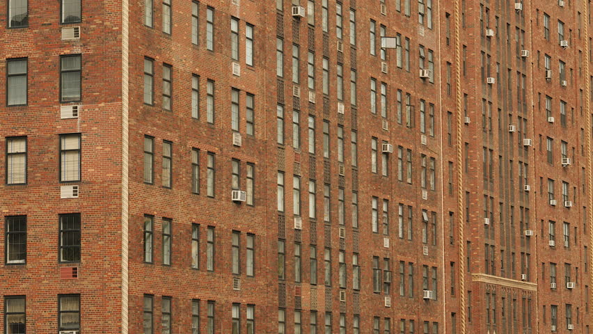 Facade And Windows Of Brick Apartment Building On W23 Street In New York City