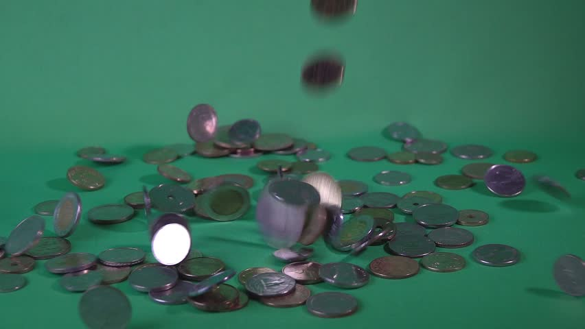 Coins of different countries fall from above on a green background. Slow-motion shooting 10 times | Shutterstock HD Video #27224740
