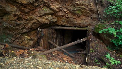 Uranium mine in Russia. Drops of radioactive water at the entrance to the mine. Water, cloudy from radon dissolved in it.