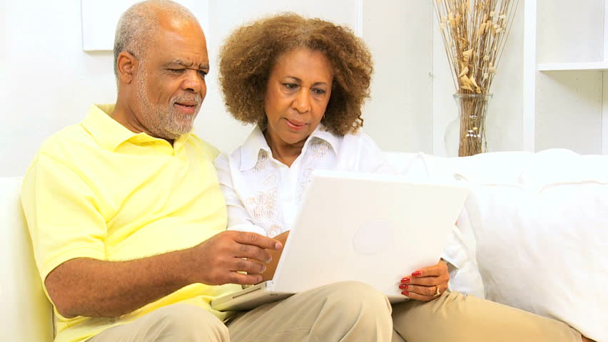 African American Grandparents Young Granddaughter At Home -2511