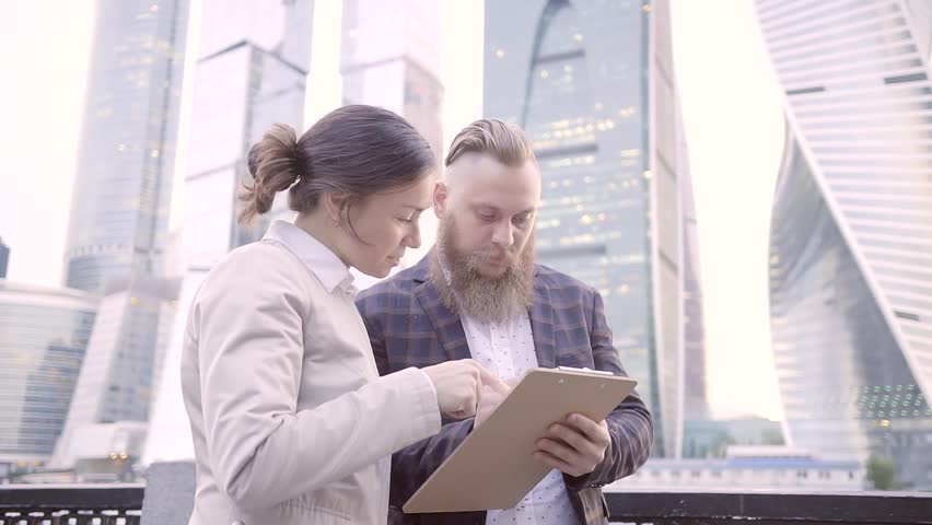 Business partners discuss the strategy of the business and build plans using paper and pen to write down my thoughts. | Shutterstock HD Video #27258610