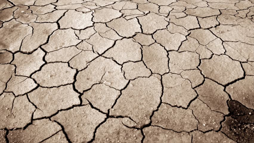 Dried and cracked land over dramatic sky  | Shutterstock HD Video #2730212