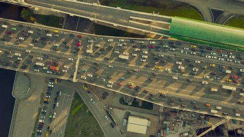 Aerial top down view shot of traffic jam on both sides of a highway in the evening rush hour. 4K video