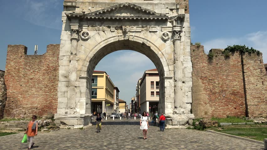 Woman Passing Under Roman Arch