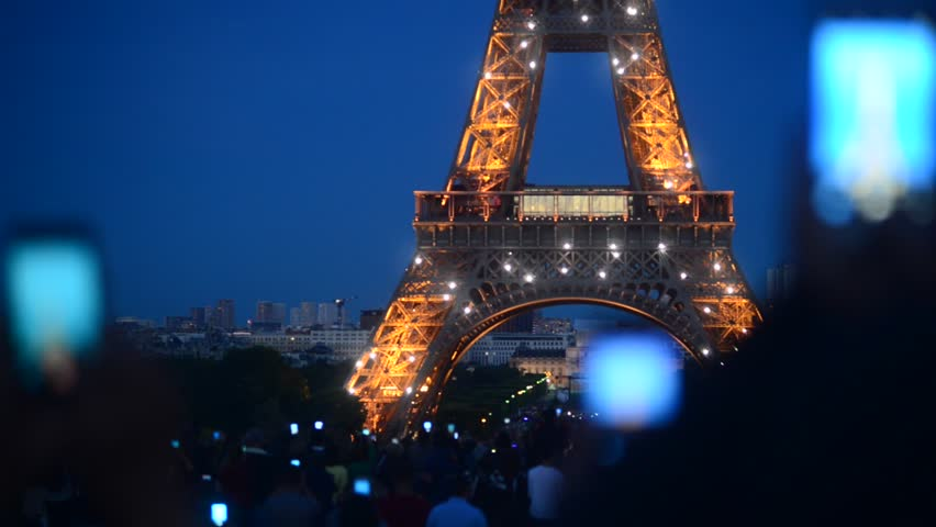 PARIS, FRANCE - MAY 21, 2017: Tourists Phones shooting Video of Millenium Illumination of Tour Eiffel in Paris Light up in Evening | Shutterstock HD Video #27329500