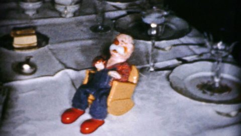 CLEVELAND, OHIO, DECEMBER, 1956: A cute little carving of an old man in a rocking chair blows smoke rings during the Christmas season in Cleveland, Ohio in 1956.