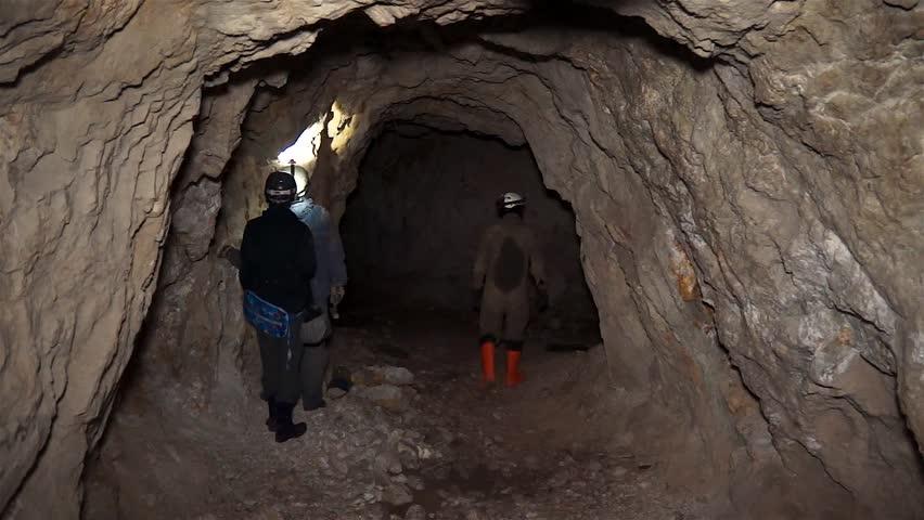 The workers walks the uranium mine. Uranium ore among limestone. Radioactivity. Inspection of the mine.