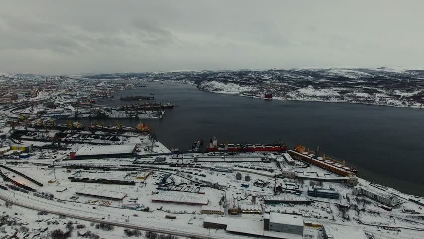 Beautiful aerial air winter vibrant view of Murmansk, Russia, a port city and the administrative center of Murmansk Oblast, Kola peninsula, Kola Bay, shot from quadrocopter drone  | Shutterstock HD Video #27362350