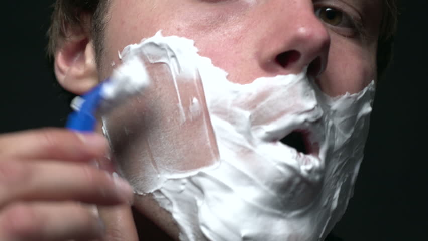 Close up of man shaving, right side