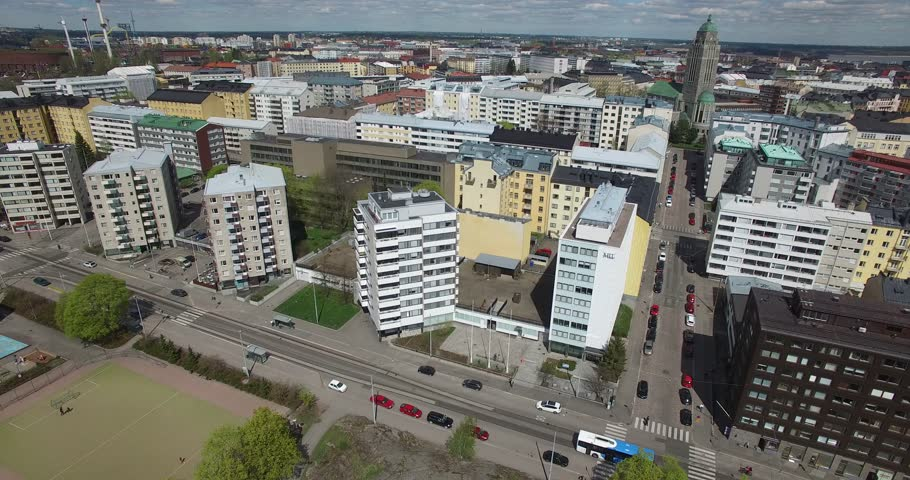 Aerial view drone footage of Helsinki old Lutheran church area built in 1912 of grey granite, area, residential buildings and urban city skyline view in the capital of Finland, northern Europe