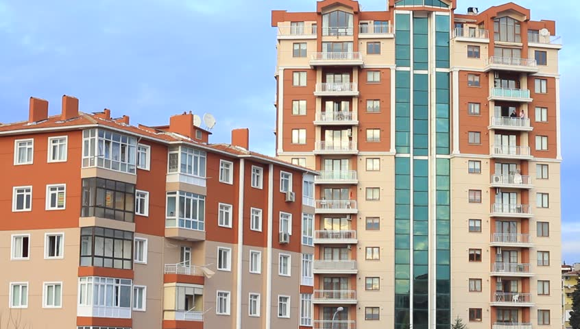 Apartment building. Multistoried modern and stylish living block of flats.