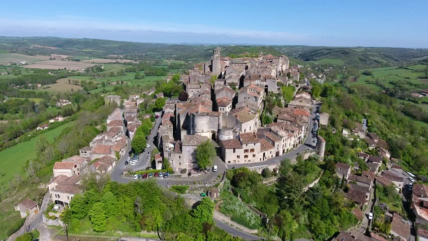 Aerial view. Cordes-sur-Ciel,  a village in a hill  (Occitanie, Southern France) 2-2 The fortified town was built in 1222 by Raimon VII. Cordes become a bastide.