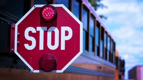 Moody Color Corrected School Bus Stop Light blinking - depressing back to school concept