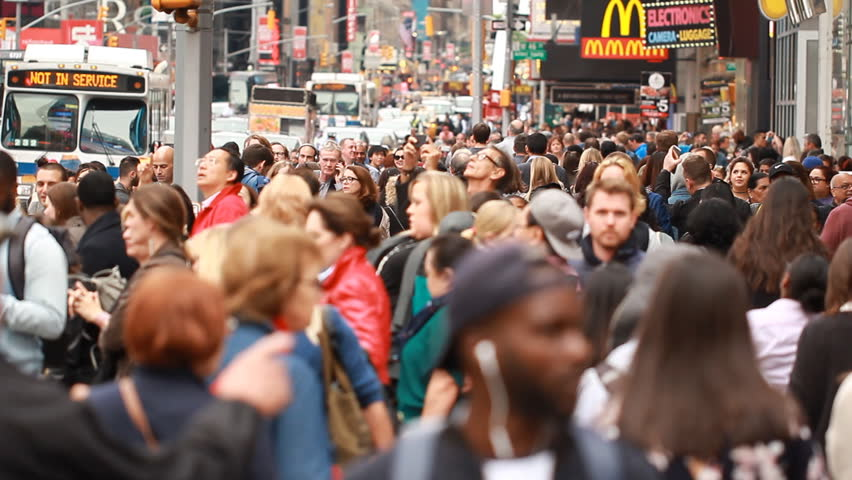 NEW YORK, NEW YORK/USA - May15, 2017: Busy Crowd of business people walking nightlife at Times Square, in New York, New York has become an iconic symbol of United States.
